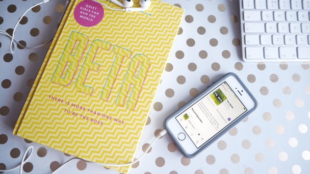 Image of book and phone with podcast showing